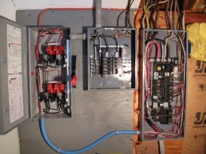 The main electrical panel to the right was existing.  We added the generator transfer switch to the left and generated power panel in the middle.